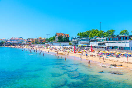 CASCAIS, PORTUGAL, MAY 31, 2019: People are enjoying a sunny day on Conceicao beach in Estoril, Portugal