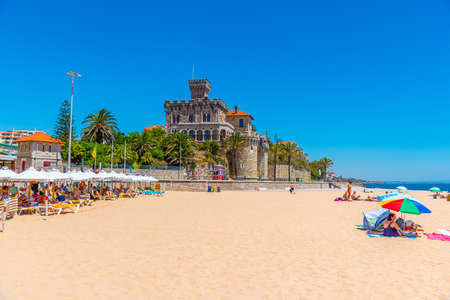 ESTORIL, PORTUGAL, MAY 31, 2019: Estoril castle viewed behind Tamariz beach in Portugal