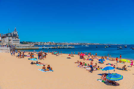 CASCAIS, PORTUGAL, MAY 31, 2019: Seixas palace viewed behind Praia dos Pescadores beach in Cascais, Portugal