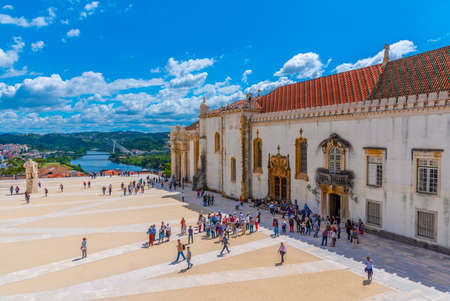 COIMBRA, PORTUGAL, MAY 21, 2019: People are strolling at the yard of the university of Coimbra in Portugal