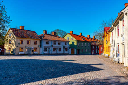 LINKOPING, SWEDEN, APRIL 23, 2019: View of traditional timber houses in the old town Gamla Linkoping, Sweden