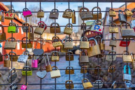 VASTERAS, SWEDEN, APRIL 19, 2019: Timber buildings in Gamla stan part of Vasteras viewed behind love locks, Sweden