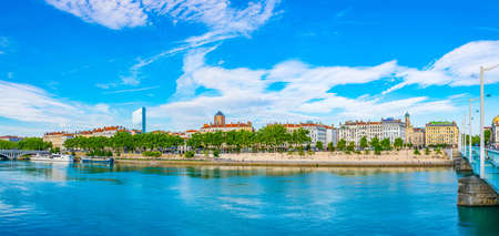 LYON, FRANCE, JULY 23, 2017: Riverside of Rhone river with Part Dieu center on background in Lyon, France