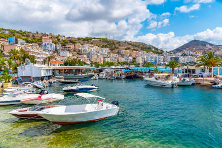 SARANDE, ALBANIA, SEPTEMBER 26, 2019: Boats mooring alongside seaside promenade at Sarande, Albania
