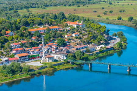 Aerial view of Buna river and adjacent village near entrance to Skadar lake in Albania