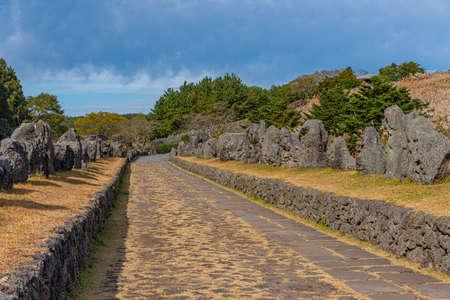 Stone statues at the entrance to Sangumburi crater at Jeju island, republic of Korea