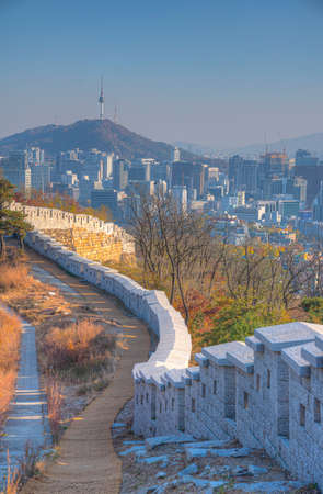 Sunset view of Namsan tower viewed behind an ancient wall at Inwangsan mountain in Seoul, Republic of Korea