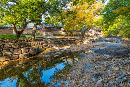 Dongnakdang house reflecting on a creek at Oksan, Republic of Korea