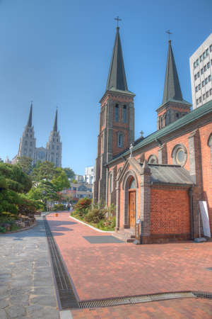 Jeil church viewed behind cathedral of our lady of Lourdes at Daegu, Republic of Korea