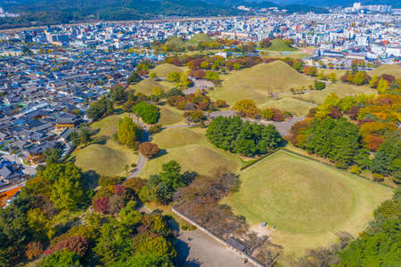 Panorama of Tumuli park and other royal tombs in the center of Korean town Gyeongju