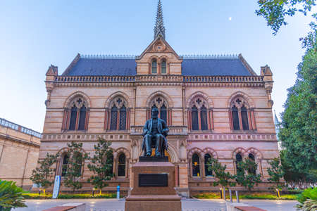 Sunset view of statue of Sir Walter Hughes in front of the University of Adelaide in Australia