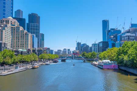 MELBOURNE, AUSTRALIA, DECEMBER 31, 2019: Cityscape of Melbourne behind Yarra river, Australia