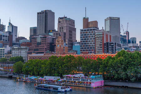 MELBOURNE, AUSTRALIA, DECEMBER 31, 2019: Sunset view of cityscape of Melbourne behind Yarra river, Australia Stock Photo