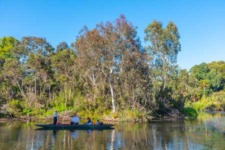MELBOURNE, AUSTRALIA, DECEMBER 31, 2019: Gondola cruising an artificial pond Royal botanic garden in Melbourne, Australia