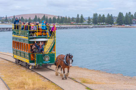 VICTOR HARBOR, AUSTRALIA, JANUARY 5, 2020: Horse drawn tram on a wooden causeway at Victor Harbor, Australia