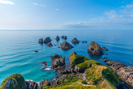 The nuggets - rocky islets at Nugget point in New Zealand Stock fotó