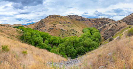 Valley of Ida Burn river at Central Otago Railway bicycle trail in New Zealand