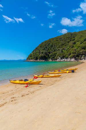 ABEL TASMAN, NEW ZEALAND, FEBRUARY 6, 2020: Yellow kayaks at Onetahuti beach at Abel Tasman national park in New Zealand