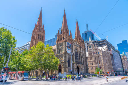 MELBOURNE, AUSTRALIA, DECEMBER 31, 2019: People are passing Saint Paul cathedral in Melbourne, Australia