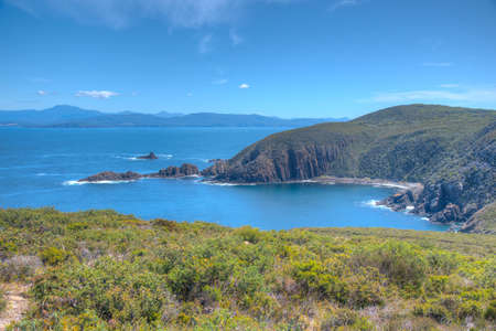 Cliffs of Bruny island viewed from Cape Bruny lighthouse in Tasmania, Australia