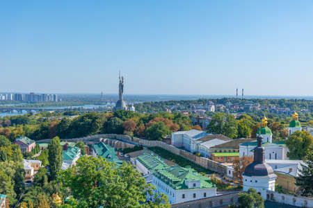 Motherland monument viewed behind Kiev Pechersk lavra in Kiev, Ukraine