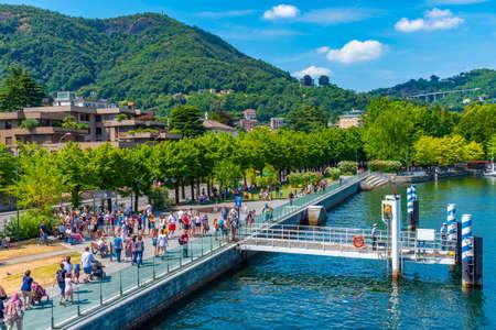 COMO, ITALY, JULY 17, 2019: Lakeside promenade alongside lake Como in Italy