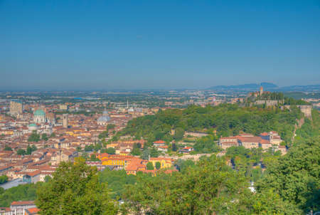 Aerial view of Brescia with castle on a hill, Italy