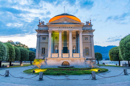 Sunset view of Tempio Voltiano on shore of lake Como in Italy