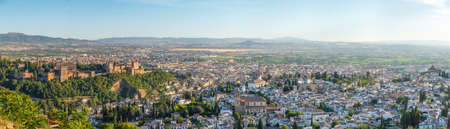 Sunset view of Alhambra palace and el Salvador church in Granada, Spain