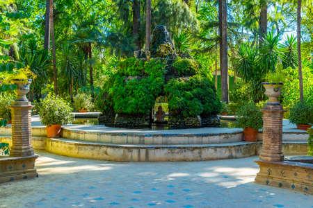 Fountain at gardens of Real Alcazar de Sevilla in Spain Stock Photo
