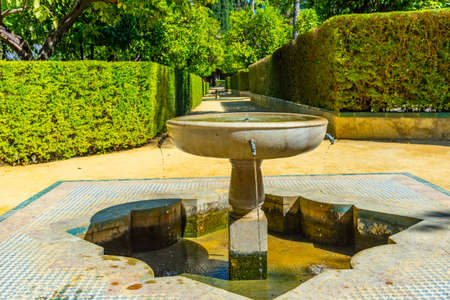 Fountain at gardens of Real Alcazar de Sevilla in Spain 版權商用圖片