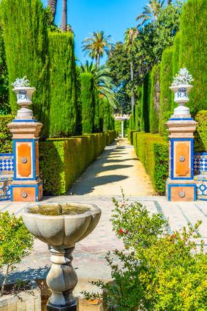 Fountain at gardens of Real Alcazar de Sevilla in Spain 写真素材