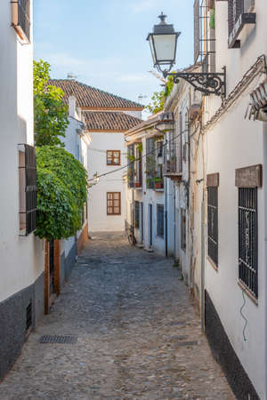 Narrow street in Albaicin district of Granada, Spain