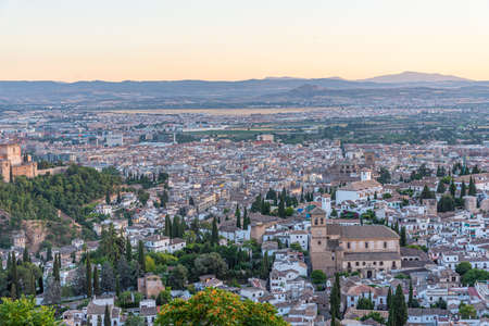 Sunset view of Alhambra palace and el Salvador church in Granada, Spain Banco de Imagens