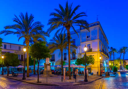 JEREZ DE LA FRONTERA, SPAIN, JUNE 26, 2019: People are strolling on a street at Jerez de la Frontera in Spain during night