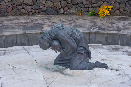 Statue of a dying mother with her child at Jeju April 3 Peace park at Republic of Korea