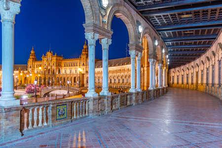 Night view of an arcade at Plaza de Espana in Sevilla, Spain