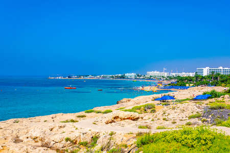 People are enjoying a sunny day at a beach at Agia Napa, Cyprus