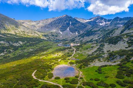 Musala peak mirroring at a surface of a mountain lake in bulgaria