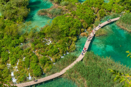 Aerial view of a wooden boardwalk leading through plitvice lakes national park in Croatia