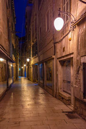 Night view of an old narrow street in the old town of Sibenik, Croatia