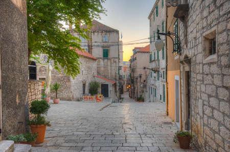 Old narrow street in the old town of Sibenik, Croatia