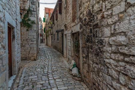 Old narrow street in the old town of Trogir, Croatia