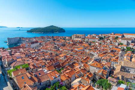 Aerial view of red rooftops of old town of Dubrovnik and Lokrum island, Croatia Stock fotó