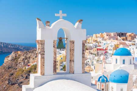 Churches and blue cupolas of Oia town at Santorini, Greece