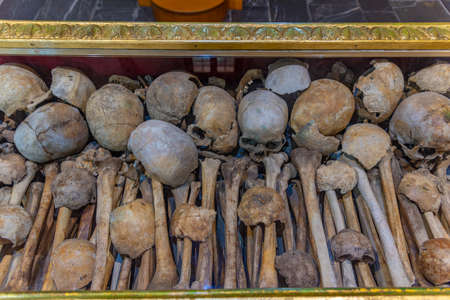 Batak, Bulgaria, June 21, 2020: Skulls and bones inside of the old church in Batak, Bulgaria