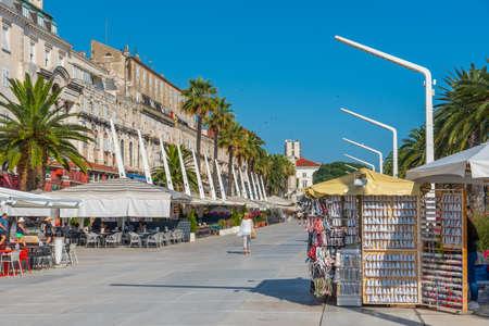 People are walking on seaside promenade in Split, Croatia