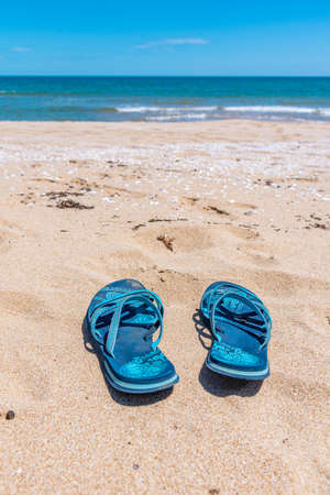 A pair of flip flops on a sandy beach in Bulgaria