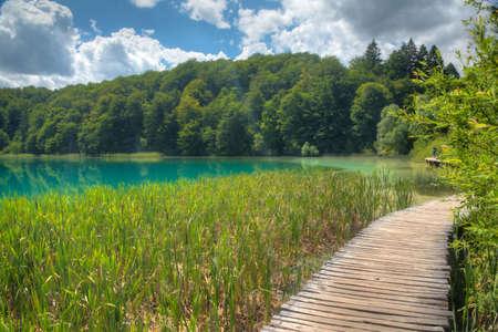 Wooden boardwalk leading through plitvice lakes national park in Croatia