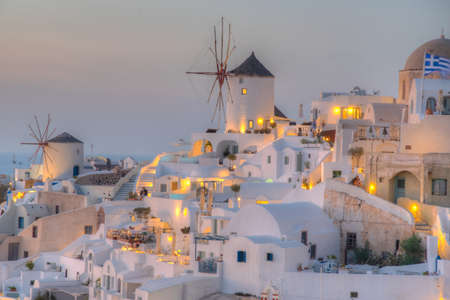 Sunset over Oia village In Santorini island, Greece